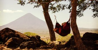 Canva - Person Lying on Black and Red Hammock Beside Mountain Under White Cloudy Sky during Daytime